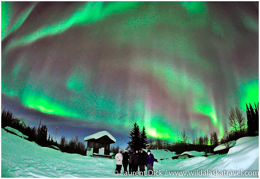 Alaska Northern Lights Tour guests under aurora in Wiseman