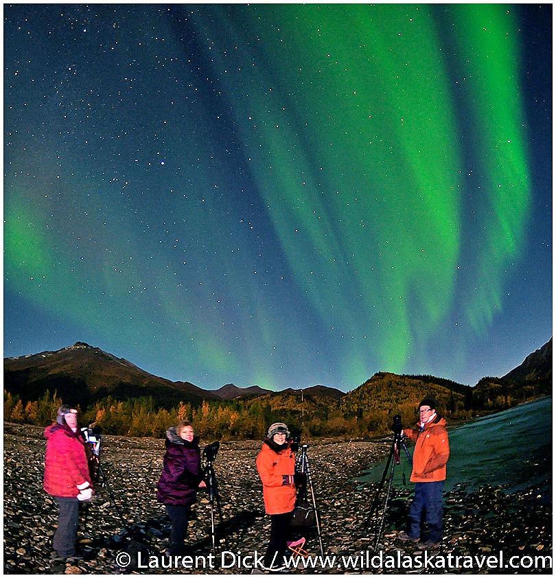 Wild Alaska Travel guests photograph the northenrn lights in Wiseman.